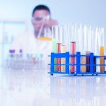 A chemist examining the liquids in the testing chemistry tubes